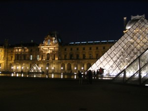 I.M. Pei's famous glass pyramid juxtaposed with Renaissance architecture at the Louvre Museum