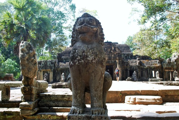 Banteay Kdei entrance with lion guardian.