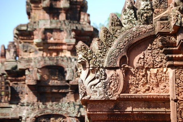 Detail of naga and relief sculpture at Banteay Srei.