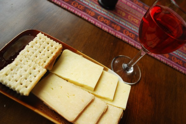 Yak cheese with crackers and sweet red wine.