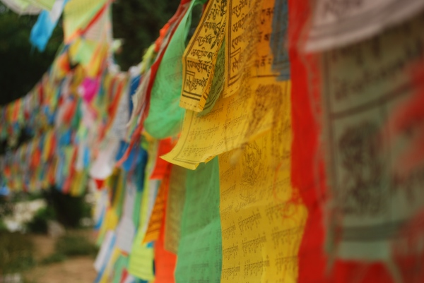 Tibetan prayer flags strung along the Old Town Temple perimeter.