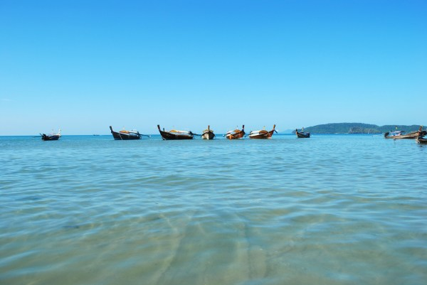Longtail boats floating near shore on Ao Nang.