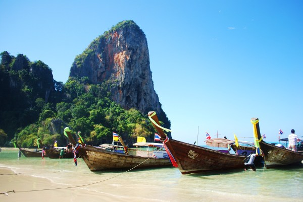 Longtail boats along Railay Beach.