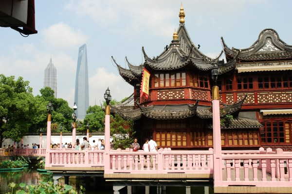 Traditional architecture in Yuyuan juxtaposed with Pudong skyscrapers.